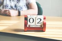 Teachers desk with calendar and apple